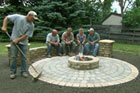 Roger Cook builds a circular patio that features a fire pit