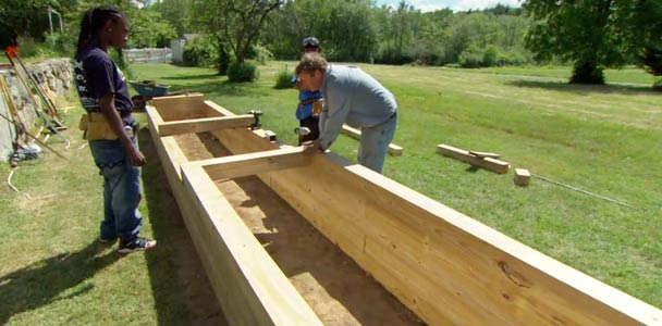 Roger Cook builds a raised garden bed for wheelchair access