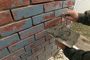 re-applying mortar to a brick foundation