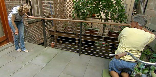 Tom Silva installs a cable railing on a deck