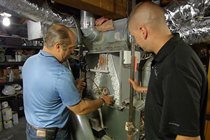 Richard Trethewey shows how to prevent ice buildup from shutting down an air-conditioning system