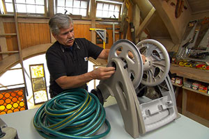 Tom Silva and host Kevin O'Connor show other uses for an old hose reel