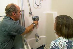Richard Trethewey helps a homeowner silence a shrieking shower