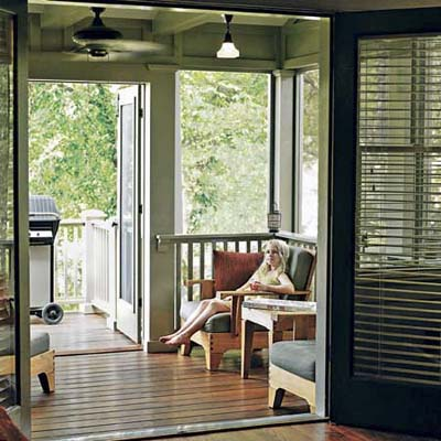 Screened in porch overlooking nearby tree tops with french doors leading to the deck